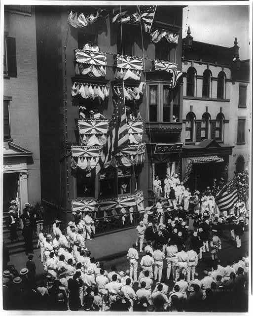 [Ceremonies, possibly on the Fourth of July, at an Elks Club; band and crowd on street; Troy, N.Y.?]