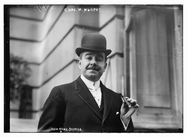 Chas. W. Murphy holding cigar