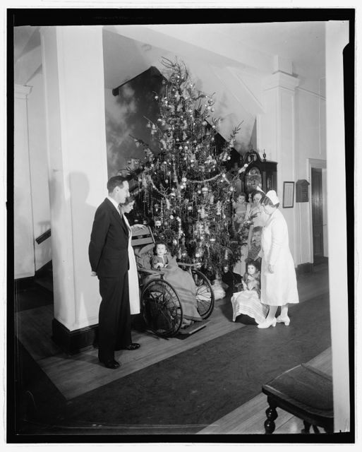 [Christmas tree with children in wheelchairs]