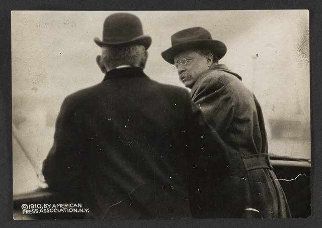 Col. Roosevelt on bridge of the Queen Maud during voyage from Elsimore to Copenhagen, talking with Aml [i.e. Admiral?] Richelieu, head of merchant marine of Norway