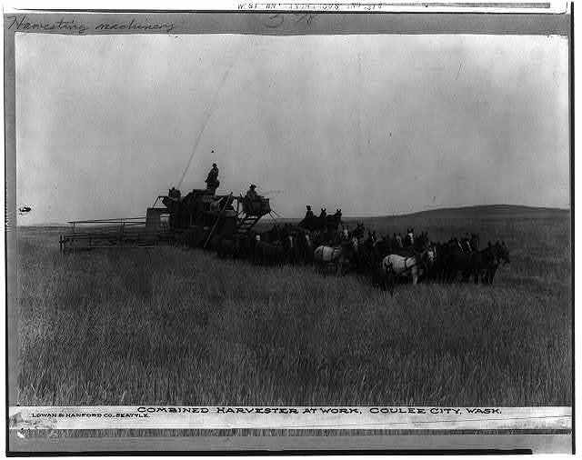 Combined harvester at work, Coulee City, Wash.