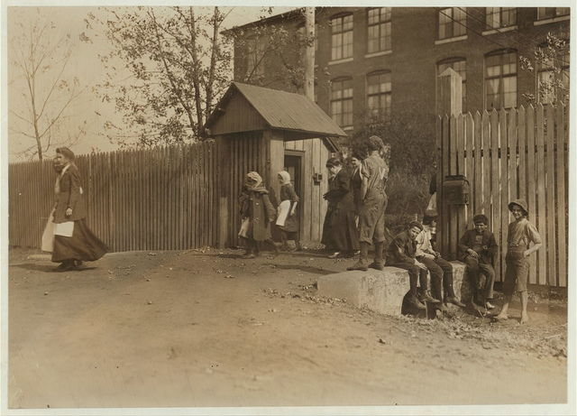 Coming out at noon, Merrimac Mills. All workers, even the boys at the side of the gate.  Location: Huntsville, Alabama.