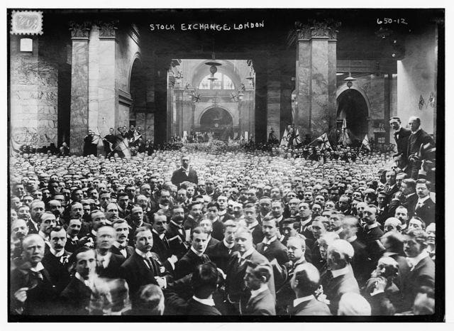 Crowd on stock exchange floor, London