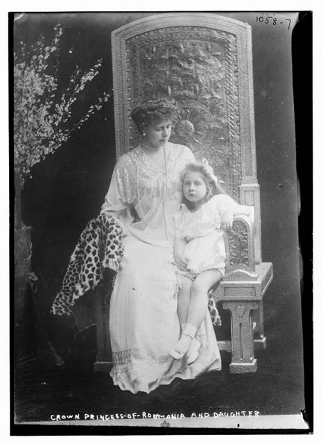 Crown Princess of Roumania seated with her daughter