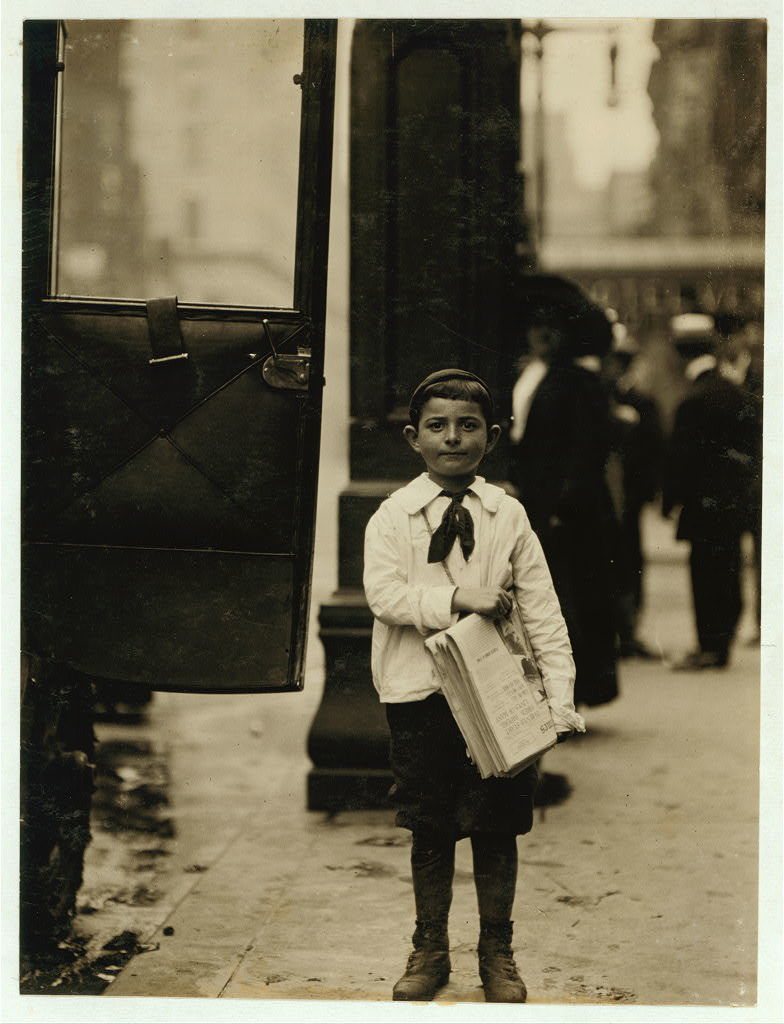 Dominick Carroll, 8 years old (appears 6). Newsboy. Sells from 3 P.M. to 7 P.M. income 25 cents per day. This boy sells papers for his brother who is 12 years old. Does not gamble, drink or smoke. Edward F. Brown, Investigator.  Location: Philadelphia, Pennsylvania / Photo by Lewis W. Hine.