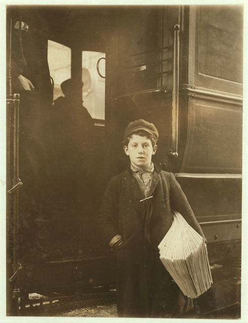 Donato Dandrea, 231 W. Genesee St. Said he was 14 years old, but if so is undersized. Does not go to school. Sells all day and in the evening, on cars, at corner on Main St., (See Nos. 1215, and 1214.)  Location: Buffalo, New York (State)