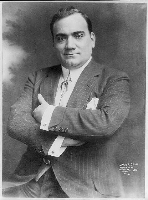 [Enrico Caruso, 1873-1921, half-length portrait, seated, facing left, arms folded]