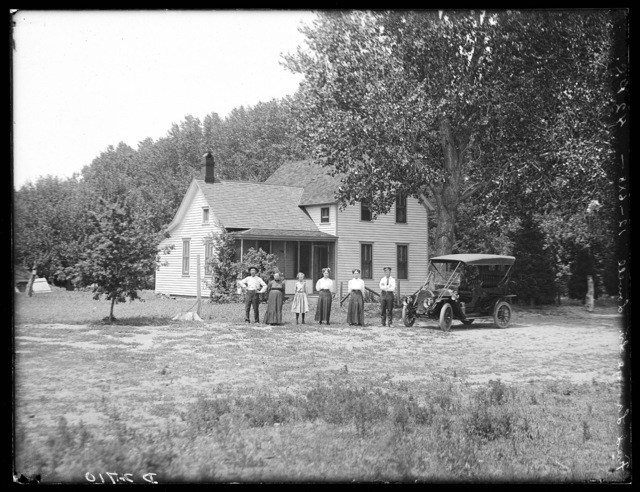 Family and their new automobile in front of the Fred Lange house, Lowell, Nebraska.