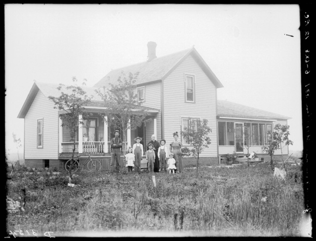 Family in front of R.P. Zimmerman house southeast of Shelton, Nebraska.