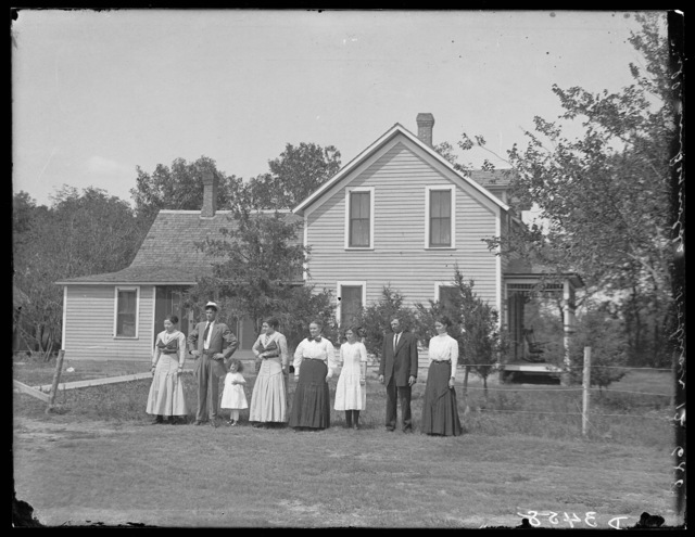 Family in front of the William Reynolds' house west of Wood River, Hall County, Nebraska.