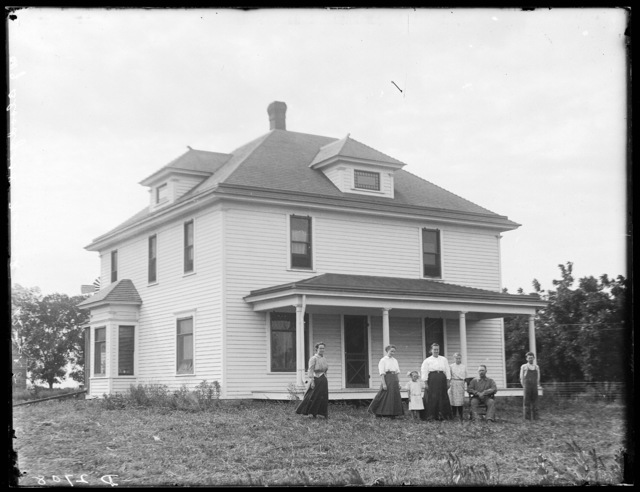 Family in front of the W.J. Bloodgood house west of Lowell, Nebraska.