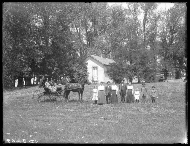 Family in front of W.A. Smith house, southwest of Gibbon, Nebraska.