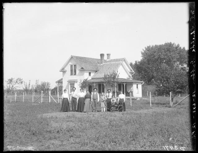 Family in front of W.T. Shields' house east of Buda, Buffalo County, Nebraska.