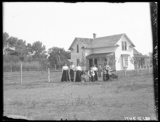 Family in front of W.T. Shields' house east of Buda, Buffalo County, Nebraska.
