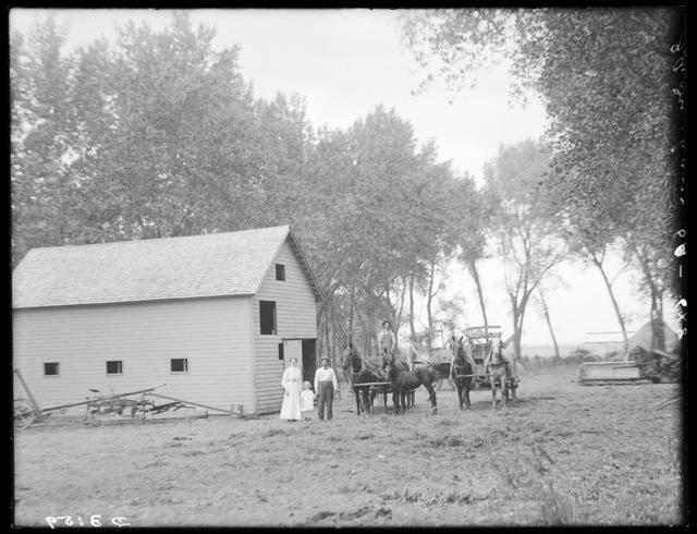 Family near the barn owned by R.A. Dunham north of Shelton, Nebraska.