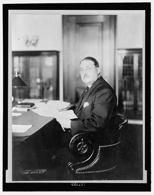[Frank B. Brandegee, Republican senator from Connecticut, half-length portrait, seated in his office]