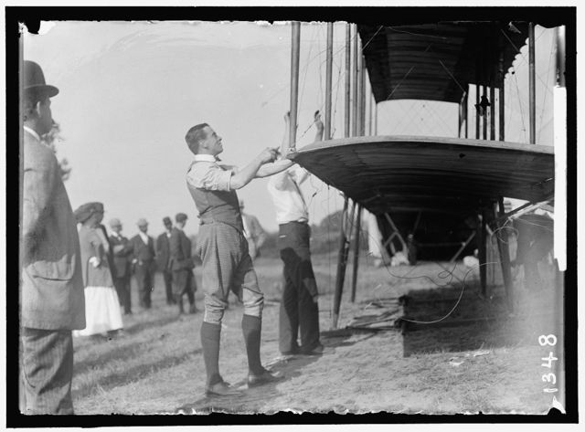 GRAHAME-WHITE, CLAUDE. FIXING WING OF HIS FORMAN PLANE