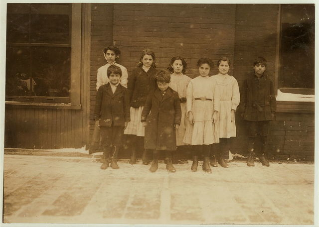 Group of children from Canneries in School #3, Buffalo, N.Y. 1) Carlo Ciaravina, 124 State St., 8 years old. Worked on beans and corn in sheds at Albion, N.Y. Entered school December 5th. 2) Mike Miranda, 8 years old last summer. Stringing beans in the home at Forsetville. Entered school September 7th. 3) Louis Belilta, 61 Water St., 12 years old last summer. Worked part of the time snipping beans in the sheds at Collins, N.Y. 4) Rose Moreibella, 41 Peacock St., 11 years old last summer. Stringing beans part of the time in the sheds at North Collins and Cherry Creek, N.Y. 5) Josephine Favata, 62 Main St., 10 years old last summer. Said that when little sister slept, she husked corn and string beans in the big shed at Albion, N.Y. 6) Magaline Tutarchi, 62 Main St., 8 years old last summer. Stringing beans and shelling peas sometimes in the sheds at Mr. Morris, N.Y. 7) Bombe Regis, 69 Water St., 9 years old last summer. Stringing beans in the sheds. Entered school in September. 8) Rosa Guglinzza, Room 10, 62 Main Street, 10 years old last summer. Worked on berries, corn and beans in the sheds at Cherry Creek.  Location: Buffalo, New York (State)