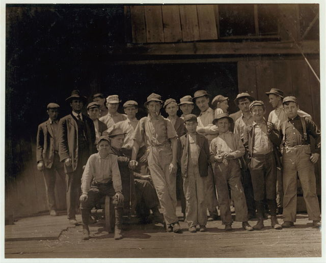 Group of glass workers at Shop 7, Illinois Glass Co. 12:30 P.M. One of the smallest boys is Dennis White, 1013 Liberty St.,.  Location: Alton, Illinois.