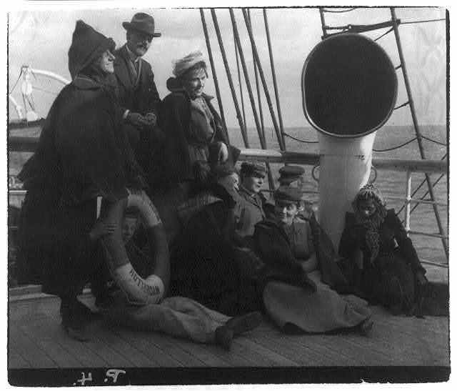 [Group of passengers on deck of S.S. Amsterdam]