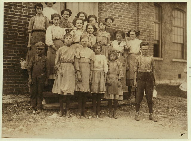 Group of spinners in Elk Cotton Mills. Youngest girl hardly knew her name. Youngest boy runs two sides at ten cents each a day.  Location: Fayetteville, Tennessee.