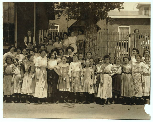 [Groups of girls workers at the gate of the American Tobacco Co., Wilmington, Delaware, noon period, May 24, 1910. Young girls obviously under 14 years of age, who work about 10 hours a day every day except Saturday. Investigator, Edward F. Brown]  Location: Wilmington, Delaware / Photo by Louis [i.e. Lewis] W. Hine, May, 1910]
