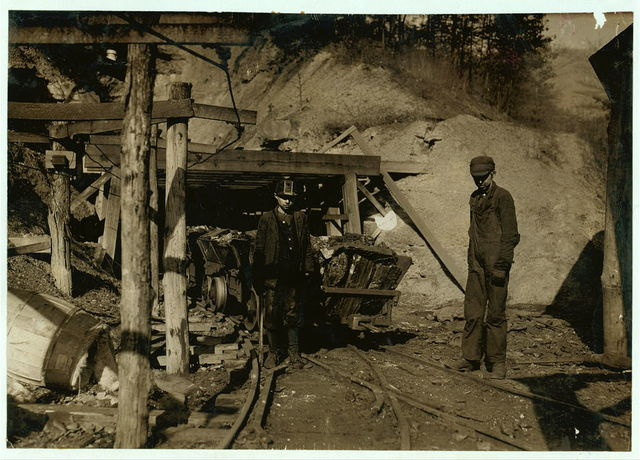 Hard work and dangerous for such a young boy. James O'Dell, a greaser and coupler on the tipple of the Cross Mountain Mine, Knoxville Iron Co., in the vicinity of Coal Creek, Tenn. James has been there four months. Helps push these heavily loaded cars. Appears to be about 12 or 13 years old.  Location: Coal Creek, Tennessee.