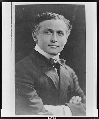 [Harry Houdini, half-length portrait, facing front, with arms folded]