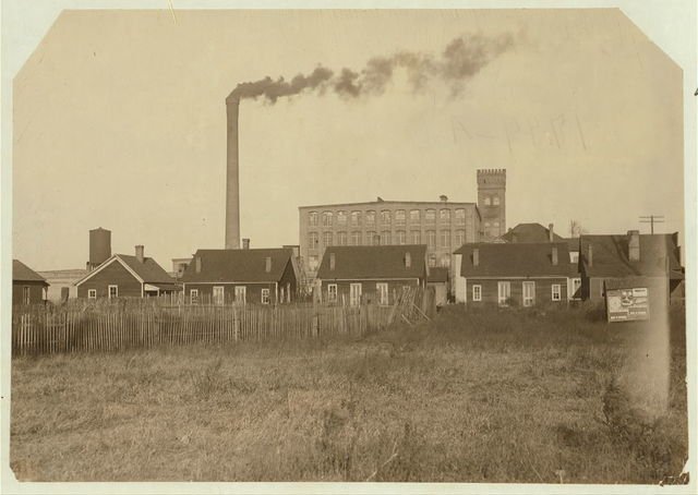 """""""Hell's Half Acre,"""" a row of disreputable houses at the edge of the mill settlement at Avondale. These houses harbor the scum of the negroes and whites of the vicinity, and are separated from the mill village by a shallow ditch, which gave Gov. Comer, owner of the mills, the excuse that they were not on the mill property when the question of their removal was taken to him a while ago. A prominent social worker told me that not only do the mill people patronize these resorts, but that the broken down mill girls end up in these houses and that there are, on court record, three cases within a year of girls under fourteen years of age ruined in Hell's Half Acre. Told me, that there are innumerable instances showing the bad moral influence of the cotton mill settlement. (See report on Avondale conditions).  Location: Birmingham, Alabama."""
