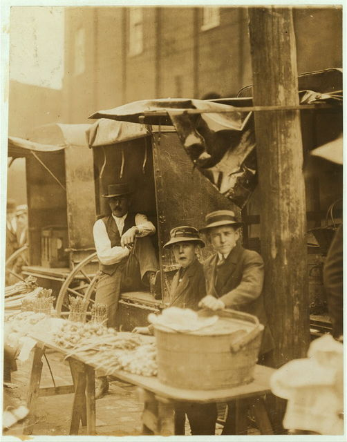 Karl Witklwskr, 812 Walnut St., Market vender. 11 years of age. 1 year at work. Works of own choice. Earns percentage of money received from stand, amounting to an average of 50 cents a week. Money not needed at home. Works of own volition. Investigator, Edward F. Brown.  Location: Wilmington, Delaware / Photo by Louis W. Hine, May, 1910.