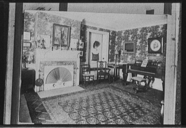 [Living room with portrait of George Washington over fireplace]