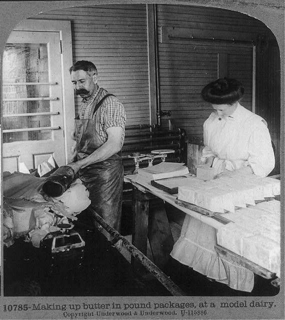 Making up butter in pound packages, at a model dairy