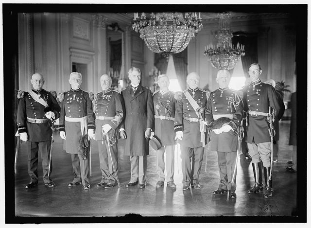 MEDAL OF HONOR OFFICERS. GEN. CHARLES F. HUMPHREY; GEN. JOHN M. WILSON; COL. CHARLES H. HEYL; GEN. THEODORE SCHWAN; COL. FREDERICK FUGER; GEN. W.H. CARTER; GEN. A.L. MILLS; LT. GORDON JOHNSTON. PICTURE TAKEN IN EAST ROOM OF WHITE HOUSE, PROBABLY ON NOVEMBER 7, 1910 WHEN MEDAL PRESENTED TO LT. JOHNSTON FOR ACT OF VALOR IN 1906