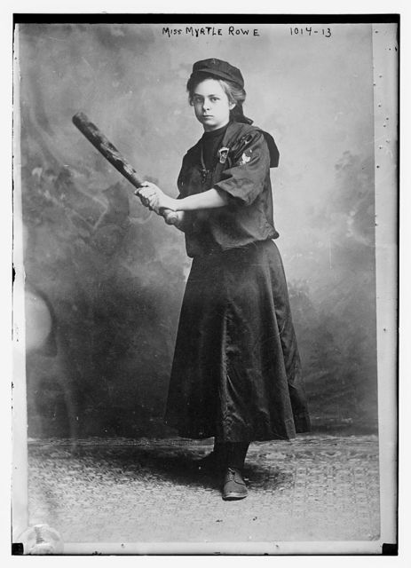 Miss Myrtle Rowe holding a baseball bat