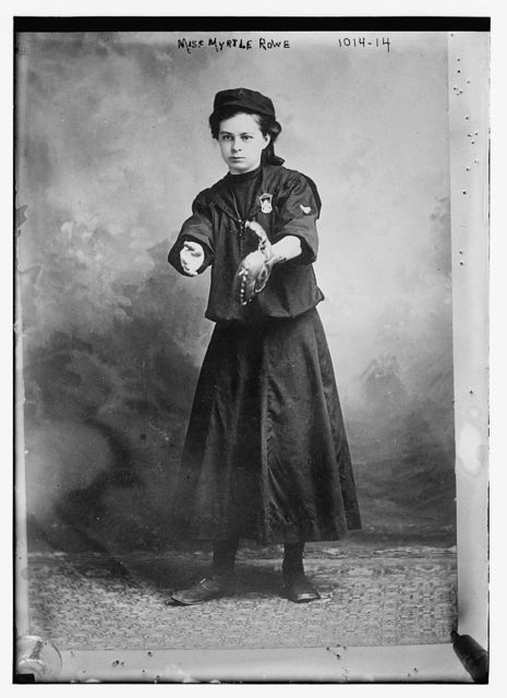 Miss Myrtle Rowe holding a baseball mitt