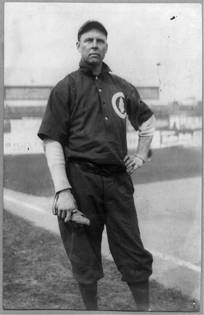 [Mordecai Peter Centennial Brown, (Three Finger Brown), baseball player for Chicago National League, posed, standing, on baseball field]