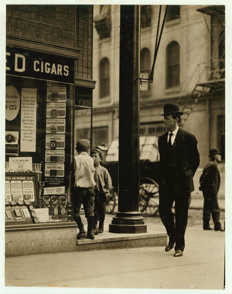 Newsboys, begging tobacco coupons. Edward F. Brown, Investigator. Lewis W. Hine. Photographer.  Location: Philadelphia, Pennsylvania.