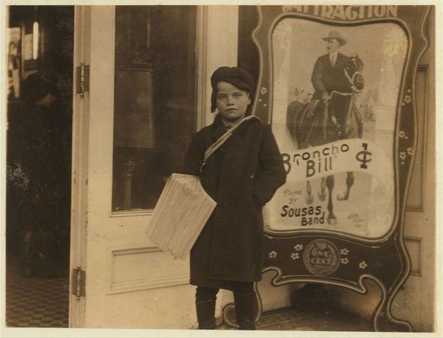 Newsie, ten years old. Going into a moving picture theatre with his papers.  Location: Schenectady, New York (State)