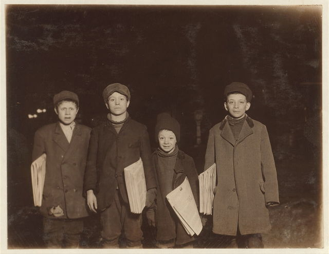 Newsies selling on Court St., 8 P.M. Left to right: Frank Spegeale, 13 years old, 72 Terrace St.; Dominick Gagliani, 10 years old, 230 Court St.; Charlie Decarlo, 8 years old; Anthony Decarlo (brother) 13 years old, 32 Front Ave.,.  Location: Buffalo, New York (State)