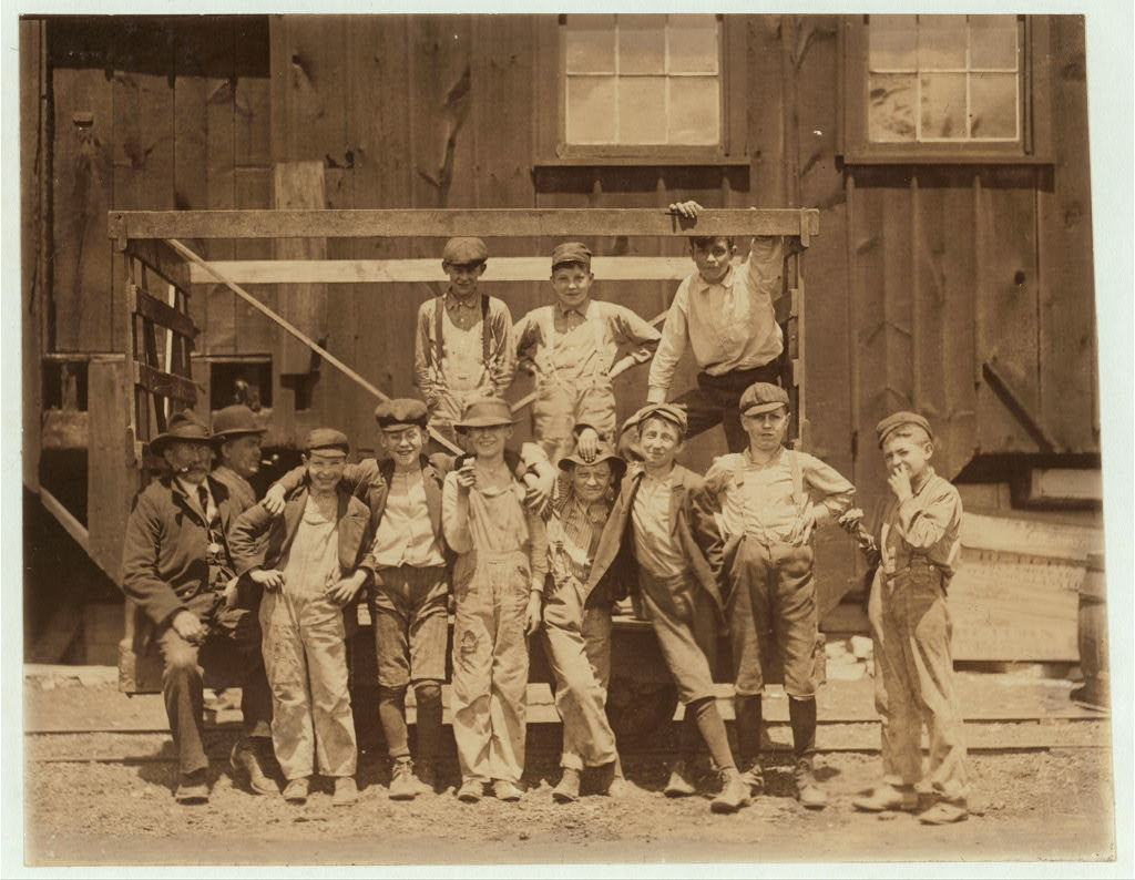 Noon hour. These boys are all working in the Illinois Glass Co. 1) Smallest boy, Frank (?) Dwyer, 1009 1/2 E. 6 St., says he has been working here 3 months. 2) Joe Dwyer (brother) Has been working here over 2 years. 3) Henry Maul, 513 Central Ave. 4) Frank Schenk, Lives with uncle, 611 Central Ave. 5) Emil Ohley, 1012 E. 6th Street. 6) Wm. Jarett, 825 E. 5th Street. 7) Fred Metz, 707 Bloomfield Street. In addition to their telling me they worked I saw them beginning work just before 1 P.M. Photo at 12:30. Alton, Ill. May 17, 1910.  Location: Alton, Illinois / Photo by Lewis W. Hine.