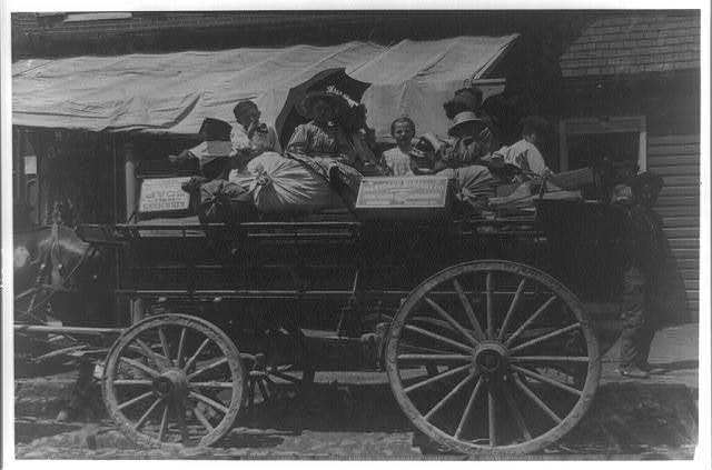 Off to the berry farms of Maryland. Taken on Fell Point, Baltimore, Md. Courtesy of Maryland Child Labor Committee.  Location: Baltimore, Maryland.
