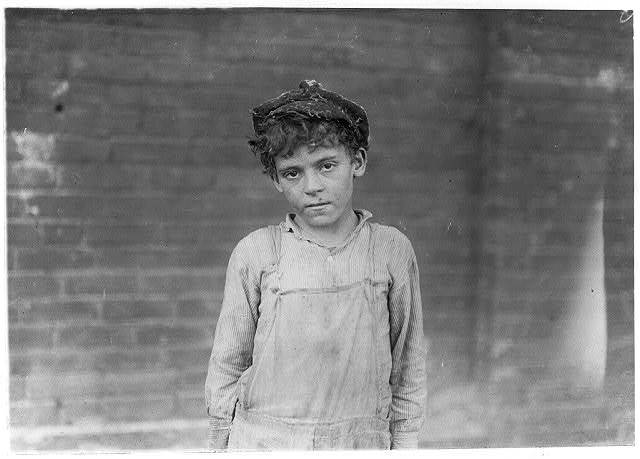 One of the young doffers working in Pell City Cotton Mill. Superintendent of mill is also Mayor of Pell City.  Location: Pell City, Alabama.