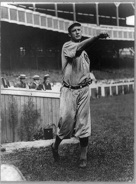 [Orval Overall, baseball player for Chicago Cubs, throwing baseball in front of grandstand]