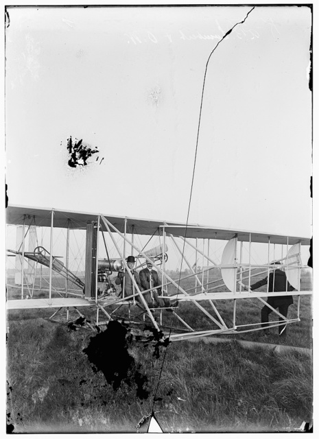 [Orville seated in Wright airplane with Albert B. Lambert before takeoff; Simms Station, Dayton, Ohio]