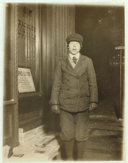Paul Cory, 14 years old. Photo taken at 10 P.M. said he sometimes sold until midnight.  Location: Buffalo, New York (State)