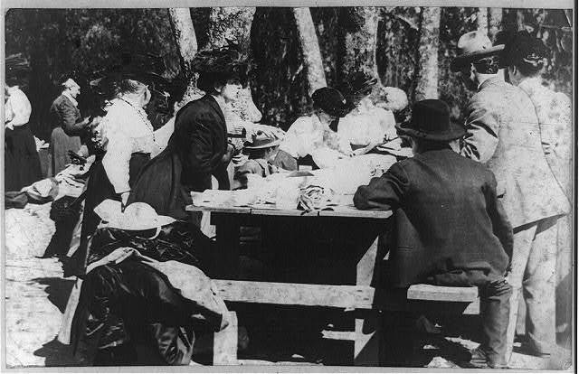 Picnicing in Sycamore Grove, Los Angeles, Calif., Feb. 12, 1910 you don't see any overcoats or snow shoes here.