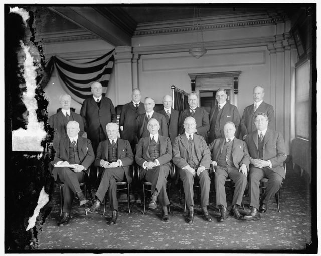 Railroad Executives J.M. Herbert; Smuel Rea; A.H. Smith; DeWitt Styler; Alred P. Thnom(?); C.E. Loomis; standing: L to R: B.M. Rubinson; F.D. Underwood; J. Kruttschnitt; E.N. Brown; Daniel Willard; W.H. Finley; W.B. Story; W.W. Aterbury.