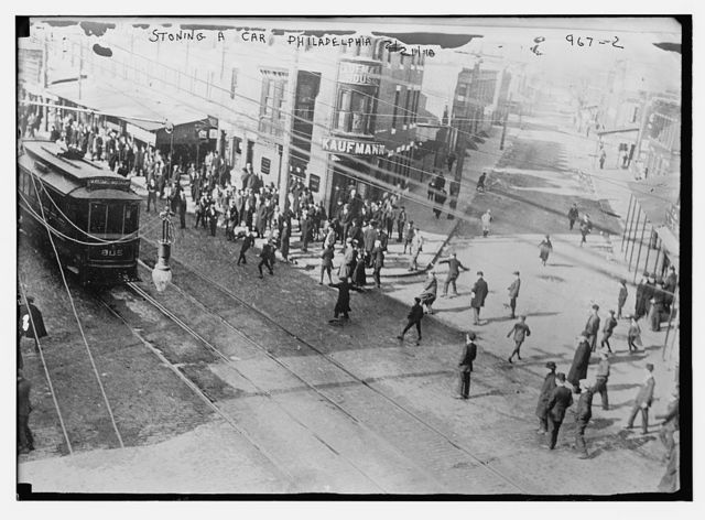 Rioters stoning a trolley car, Philadelphia