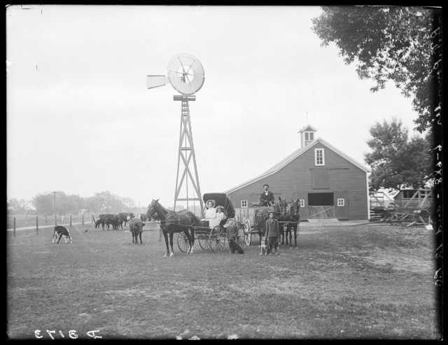 R.T. Pounder and family in front of a barn east of Shelton, Nebraska.