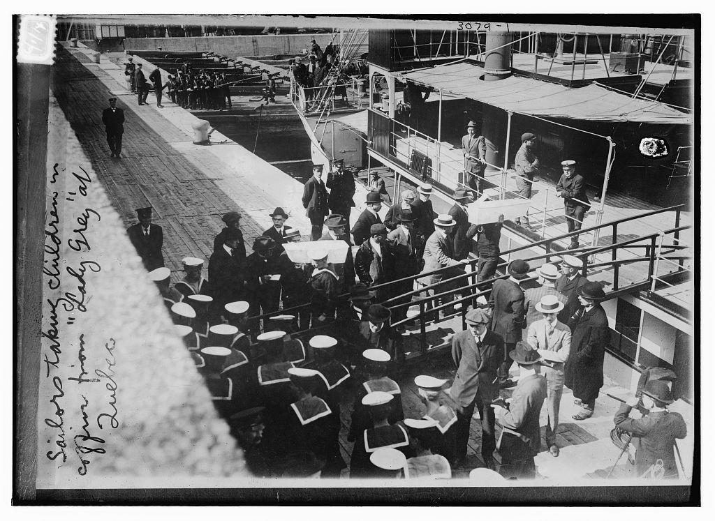 Sailors taking children in coffins from LADY GREY at Quebec